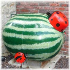 Propane Tank painted to look like a watermelon and lady bugs...too creative!!