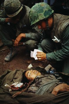 https://flic.kr/p/6F2TR3 | U1584061A | 19 Feb 1968, Hue, South Vietnam --- U.S. Marine medics treat the head wound of a North Vietnamese soldier who was found below an outer citadel wall. --- Image by © Bettmann/CORBIS