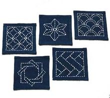 """This kit can be made into coasters, or add them to patchwork. Contains 5 traditional Sashiko designs.  finished size: 4"""" x 4"""" Kit contains: Cloth with designs pre-marked Threads Needles Thimble"""