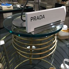 Any moonshiner would give an arm and leg for cooling coils this elaborate as outfitting for his still. But somehow I think Prada® had more of an Art Deco theme in mind. And hedging its bets, the to… Prada Outfits, Wine And Spirits, Industrial Chic, Distillery, Visual Merchandising, Creative Art, Signage, Art Deco, Arm