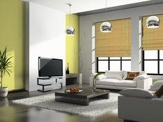 Esto es nuestro salón. Hay 2 sofás,uno de color blanco y otro de color marrón. En medio hay una mesa de café y al lado de la pared,enfrente se los sofás encontramos la tele. Las paredes son de color blanco y verde y del techo penden 3 lámparas redondas de color plateado. En esta habitación hay 2 ventanas grandes rectangulares y debajo de la mesa da café hay un alfombra blanca y muy delicada.