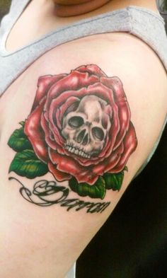 Under boobs hearts and roses tattoo