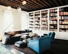 built-in bookcases + rustic beamwork + grey and blue
