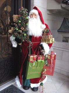 On the other side of the door, this life-size Santa is waiting to say hello too