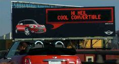 """MINI RFID interactive billboard """"talks"""" to passing MINI owners. Each billboard shows a photo of a MINI Cooper car with an EMC component that is able to identify special passing MINI owners and transmit a personal message"""