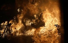 Athens, Greece: A riot police officer is engulfed by flames from a petrol bomb thrown by protesters in front of parliament.    Dimitri Messinis/AP