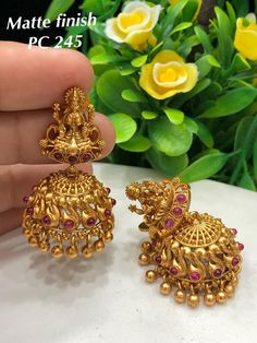 for bookings whatsapp on worldwide shipping available at Arshi's. for bookings whatsapp on worldwide shipping Gold Jhumka Earrings, Jewelry Design Earrings, Gold Earrings Designs, Gold Jewellery Design, Jhumka Designs, Gold Wedding Jewelry, Gold Jewelry Simple, Bridal Jewelry Sets, Stylish