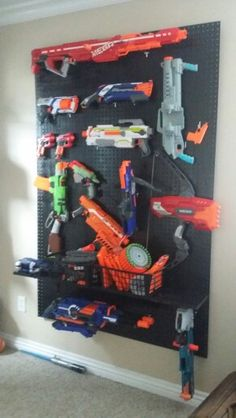Quick and easy solution to my son's Nerf gun collection! Literally took a half hour to do.....minus the paint drying time.