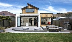 Hard wearing natural materials and double height light airy spaces within give the home it's modern bach feel. House Color Schemes, House Colors, Interior Design Inspiration, Natural Materials, Building A House, Urban, Mansions, Architecture, House Styles