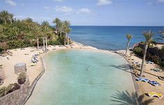 The world's best hotel pools - Rio Calma, Fuerteventura Located on the sandy beach of Costa Calma, the Rio Calma hotel features a huge pool and saltwater lagoon with a perfect view of the Atlantic.