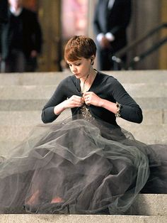 Carey Mulligan. i love the softness of this skirt with the more structured cardigan.