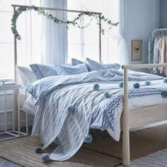 #Design Tip: Create a calming bedroom with soft shades of blue and natural materials, like this GJÖRA bed frame.