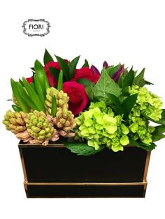 A romantic Valentines Day Flower gift. Free Oakville delivery. Spring Grouping in a Box Four romantic groups of spring bulbs, roses and green hydrangeas individually arranged and presented as one in a luxe black or white box .