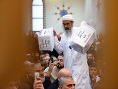 A man carries away donations boxes during Eid al Fitr prayers at a mosque in Sydney on August 8, 2013. PHOTO: REUTERS