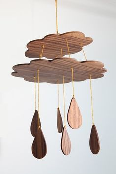 rain cloud mobile. I would do it with crystals.... Maybe even as a windchime.... Oooh now I want to make one!