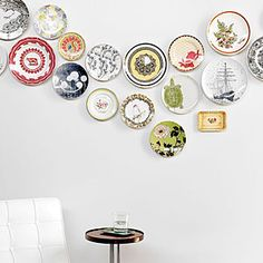 Hang colorful plates or other themed collections in wavelike pattern on a plain white wall, which allows them to pop without competing for attention.