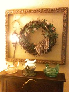 Fenton chickens, old wreath with a little recycled Sari Silk ribbon, painted picture frame and new lantern from Country Klutter in Dexter, MO