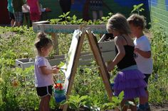 Painting in the garden in a Nature Explore Classroom at Beth El Center for Early Childhood Education.