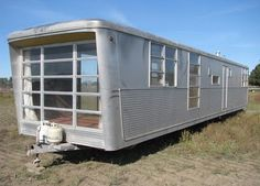 1959 Spartan Carousel. Has a circular kitchen, domed skylight, pink bath fixtures...click through for interior pics