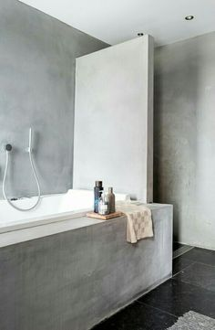 Concrete bathroom | smart partition between bathtub and shower | photography by Hans Mossel