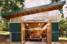 Adorable-dark-green-shipping-container-garage-plans-with-glass-doors-and-green-sloped-roof-design-also-outdoor-metal-lightings