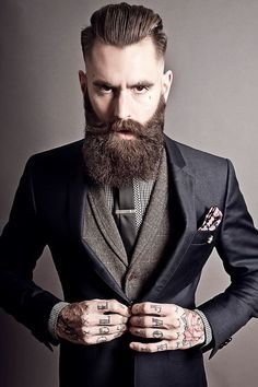 Hand tattoo, beards and smart suits. We love it at Tattoo Tailors.