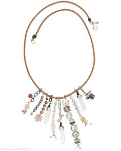 22 inches of stones, crystals and metals creates effortless style and a stunning neckline. Carnelian, Pyrite, Crystal, Brass, Quartz, Shell, Pearl, Glass, Cord, Sterling Silver.
