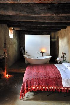 Old ceiling beams, simple furnishings, large tub
