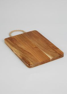 ffef66df4cf Wooden chopping board with rope handle. Dimensions  32cm x 2cm. Matalan