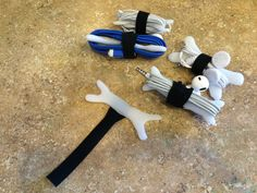 Made these chord holders with an embedded Velcro strap out of InstaMorph moldable plastic.