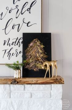 DIY Metallic Foil Brush Strokes Tree Sign... I love how modern this is for a Christmas decoration! Perfect for the mantle