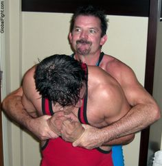 a man restrained wrestling by hot wrestler daddy