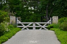 Driveway gate made of wood and stone.  A Planters design.  Highlands, NC
