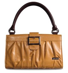 *Miche Canada* Like a warm summers day Vivian Mustard Shell for Classic Bags delights the eye and tickles the senses. Every woman needs a sunny mustard handbag on her arm especially during the warm spring and summer months and Vivian's faux leather pleats and chic over-the-top buckle closure lets you step out in style.