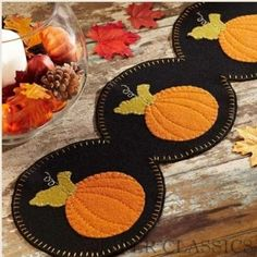 """Harvest Time Runner w/ Appliqued Pumpkins - Dress up your table for fall and harvest season with this striking pumpkin runner. Four pumpkins encircled with a black background. This runner measures 9"""" x 36"""" and is 100% felt(65% wool, 35% nylon) embellished with hand embroidery and applique. Dry clean. #autumn #table #decor"""