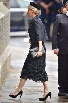 Sophie, the Countess of Wessex, opted for a textured calf-length skirt, cropped jacket and black heels for the service