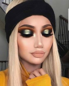 Bold makeup: orange and green metallic eyemakeup with a full face glam and nude lipstick.