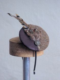 A small tweed and leather fascinator by andreahats on Etsy