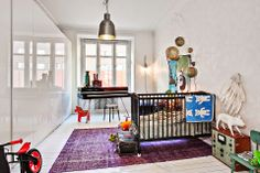 a beautiful eclectic nursery with vintage and modern details