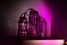This was created with jars a light with glasses over it
