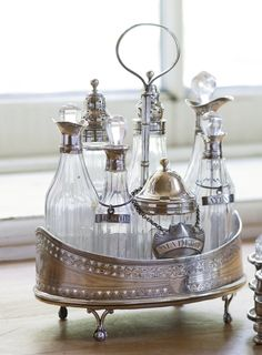 A George III silver and glass cruet stand, Robert and David Hennell, London…