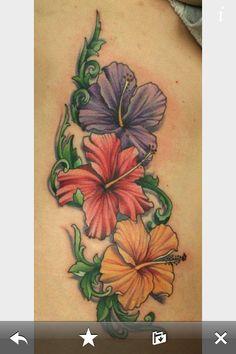 Color Hawaiian flower tattoo