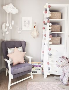 A reading corner in a little girls room, using lots of points of interest and textures including cotton cable lights and handmade mobiles.