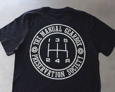 "The Curb Shop - T.M.G.P.S Insignia T-Shirt With some new items available—including ""The Manual Gearbox Presentation Society""— Curb has graciously extended a 25% discount code applicable to original Curb items* to Petrolicious readers. Simply enter ""DRIVETASTEFULLY"" at checkout!"