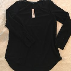 Lovely black blouse/shirt by Larry Levine NWT Designer top loaded with lace details on the shoulders and down each sleeve. There is a small v cut out in the neckline. This is lovely on. Looks great with jeans or a nice skirt or slacks. Very versatile. Larry Levine Tops Blouses