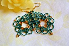 Precious tatted lace earrings, perfect accessory for your daily outfit as well as stylish addition to an elegant dress or bridesmaids gift I tatted these chandelier earrings with high quality polyester thread in emerald and matte gold seed beads. Tatting is a technique for handcrafting a particularly durable lace constructed by a series of knots and loops.The filigree tatting lace makes these statement earrings very light and so comfy to wear despite their size The polyester allows an…