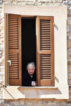 A Nonna in Spello-- my great aunt greeted us from the window just like this!