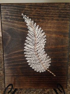 String art feather by my2heARTstrings on Etsy https://www.etsy.com/listing/227417082/string-art-feather