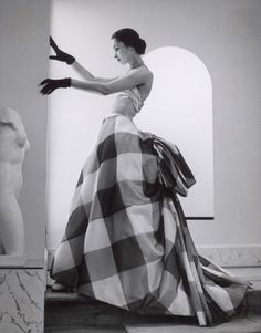 Model wearing a checked gown by Pierre Balmain, Summer 1952. Photo by André Ostier. via fotointern