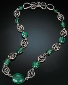 AN EARLY 19TH CENTUR EMERALD AND DIAMOND-SET NECKLACE Comprising ten closed-back rose-cut diamond-set openwork floral clusters separated by eleven polished emerald beads to a rose-cut diamond-set bow clasp, mounted in silver and yellow gold, French import mark, numbered 3582, 58 cm long.